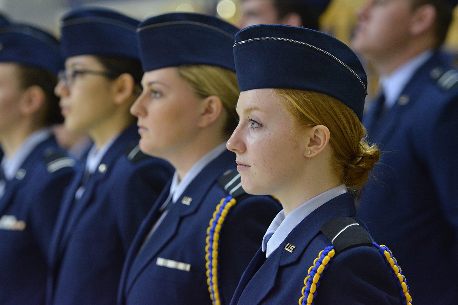 Female ROTC students stand at attention during the ceremony.