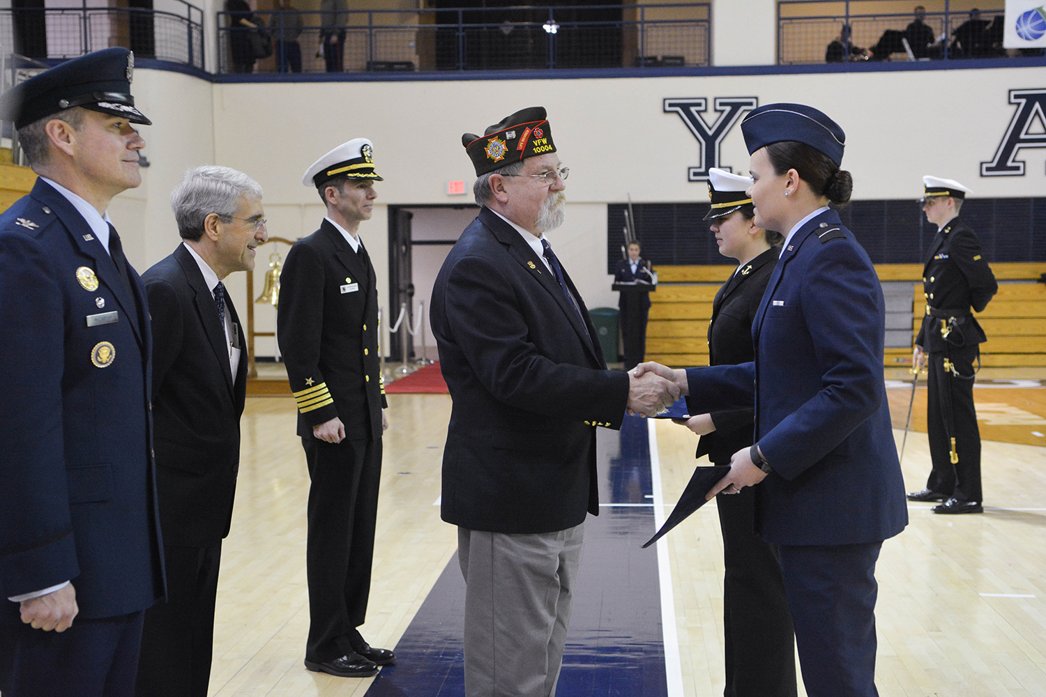 ROTC students shake hands with a Veteran of Foreign Wars.