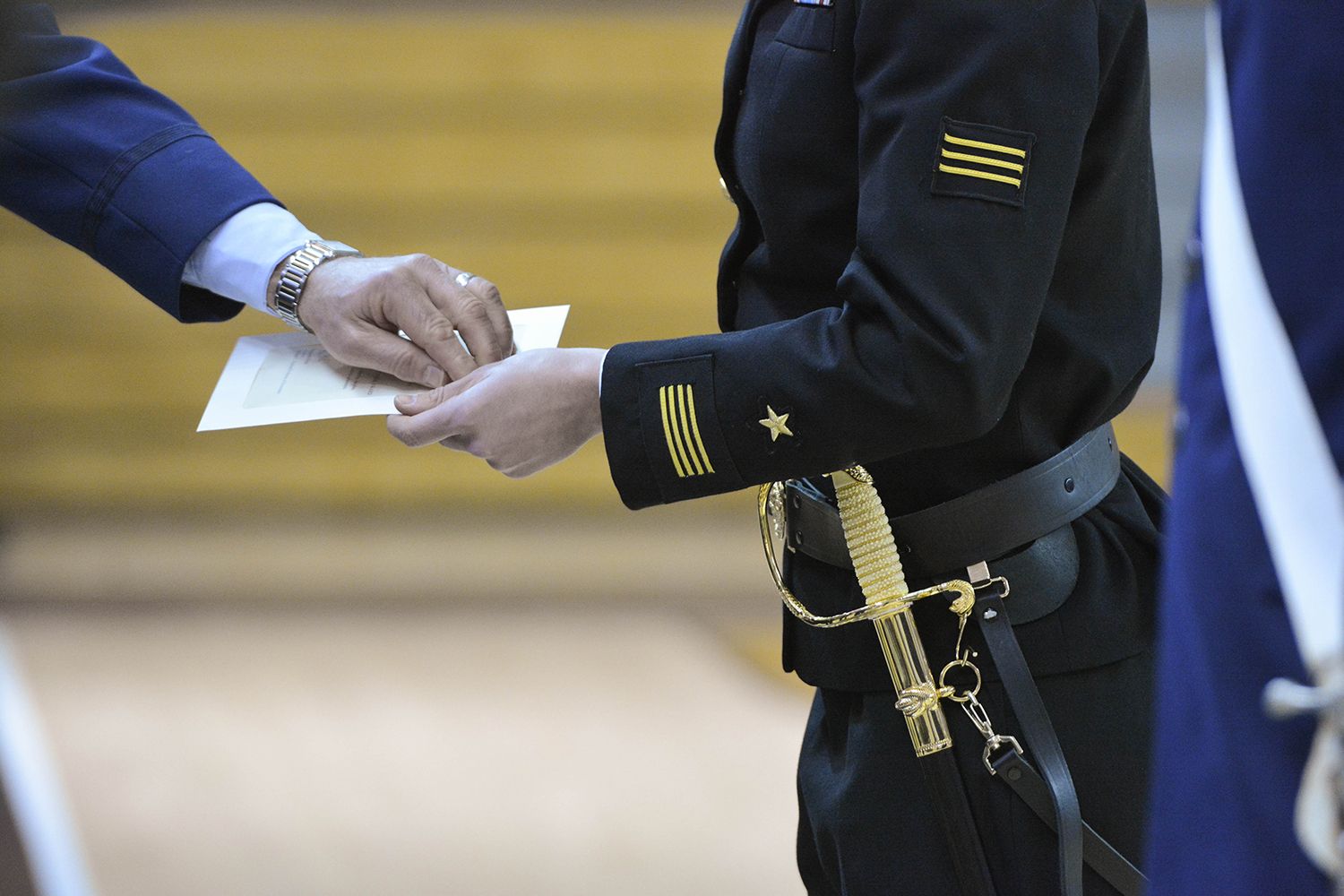 ROTC student hands Veteran of Foreign Wars a certificate.