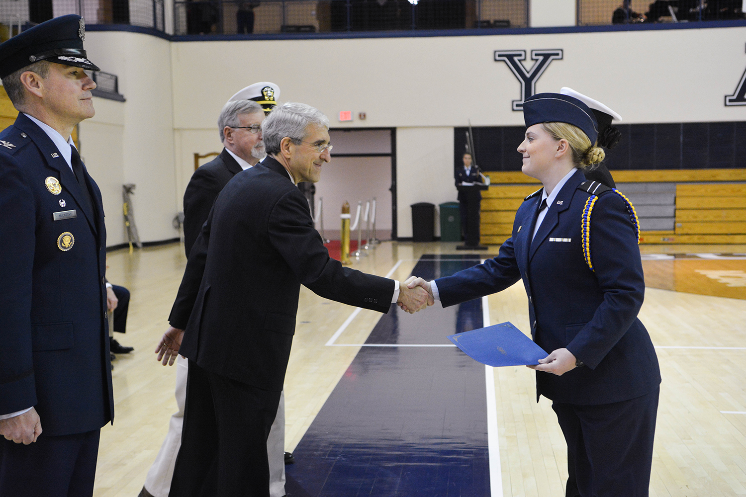President Salovey shakes hands with ROTC student.