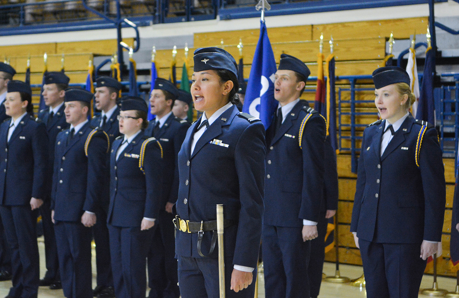 ROTC students sing during ceremony.