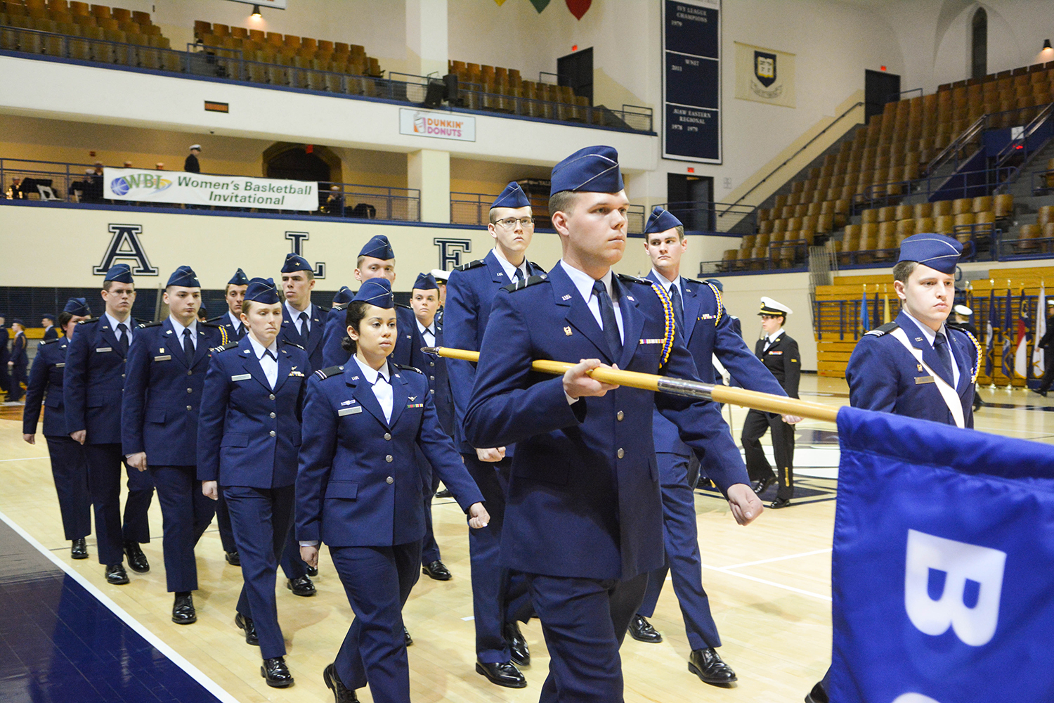 ROTC students march in formation during ceremony.
